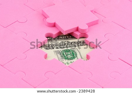 us dollar and puzzles close up, business concept