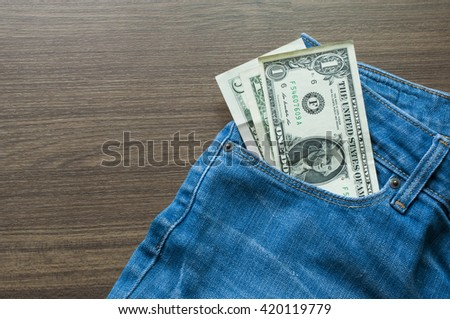 US Dollar bank note in blue jeans pocket