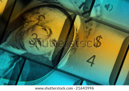 US dollar bank note overlaid onto computer keys