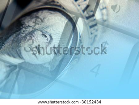 US dollar bank note overlaid over laptop keys - stock photo
