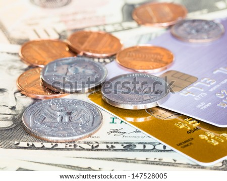 US dollar banknote, coins, and credit card - stock photo