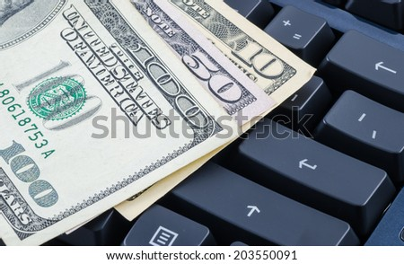 US dollar banknote on the computer keyboard - stock photo