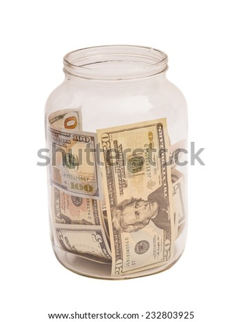 US dollar banknotes in jar on white background  - stock photo