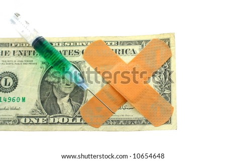 US dollar bill with band-aids and filled syringe with needle - stock photo