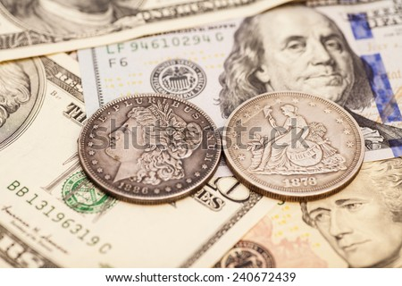 US dollar bills and coins - stock photo