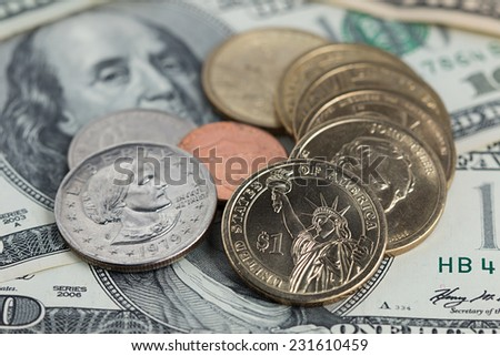 US dollar bills and coins background. - stock photo