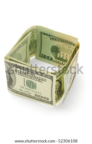US dollar bills arranged forming enclosed walls on white background