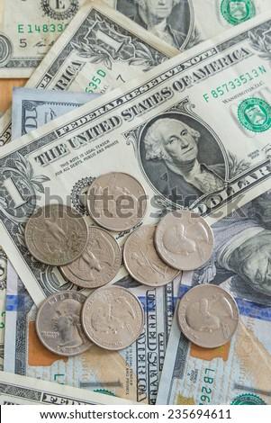 US dollar bills coins background - stock photo