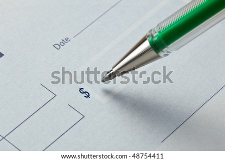 US Dollar blank check with a pen using green ink - stock photo