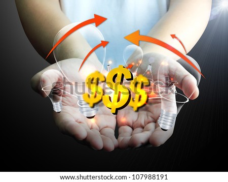 US dollar sign with light bulb in hand - stock photo