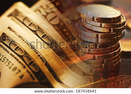 US dollars and euro coins. Finance data concept.