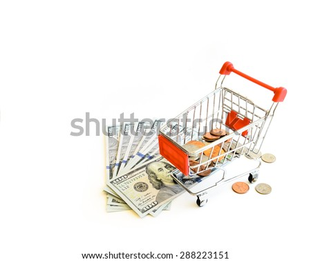 US dollars banknote and coins with shopping cart isolated on white background. Concept of currency, business, finance and online shopping/e-commerce. Copy space. - stock photo