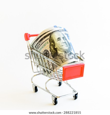 US dollars banknote with shopping cart isolated on white background. Concept of currency, business, finance and online shopping/e-commerce.