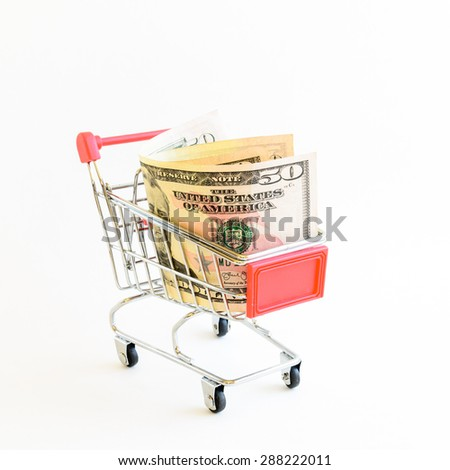 US dollars banknote with shopping cart isolated on white background. Concept of currency, business, finance and online shopping/e-commerce. - stock photo