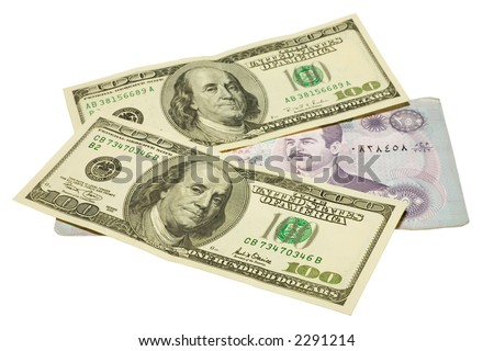 US dollars banknotes over iraq dinars with clipping path - stock photo