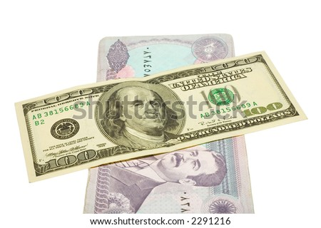 US dollars banknotes over iraq dinars with clipping path