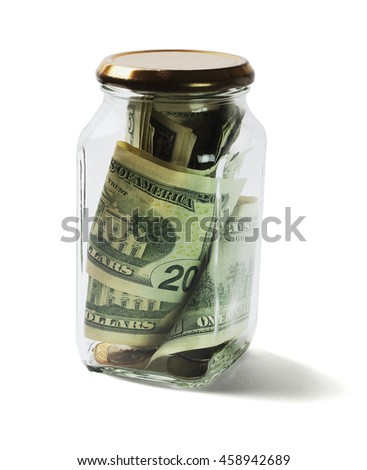 US Dollars Bills and Coins in Glass Jar Lying on White Background - stock photo