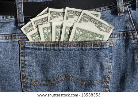 US Dollars Cash in Back Pocket of Blue Jeans - stock photo