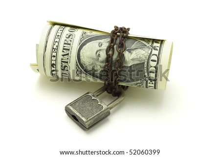 US dollars chained and locked on white background - stock photo