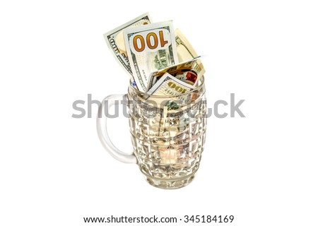 US Dollars in a beer goblet isolated on white