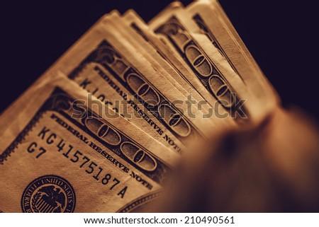 US dollars in arm. Macro image. - stock photo