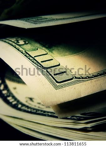 US dollars in dark style. Macro image. - stock photo