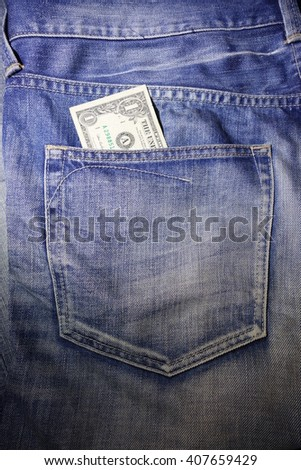 US dollars in the jeans pocket