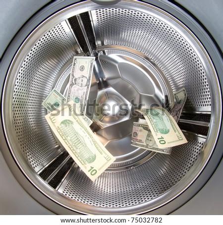 US Dollars shot in a washing machine money laundering - stock photo
