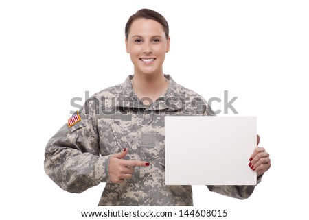US female soldier showing a blank placard  - stock photo