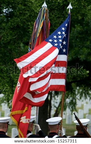 US flag and honor guard with gravestones in background Arlington National Cemetery - stock photo