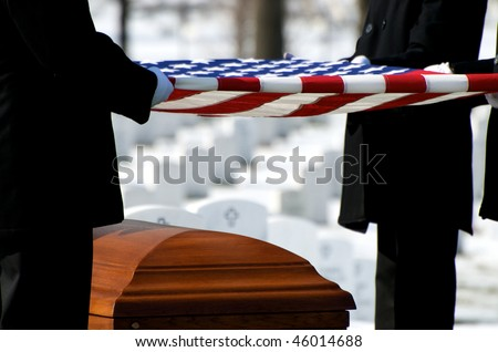 US Flag being held over casket at Arlington National Cemetery - stock photo