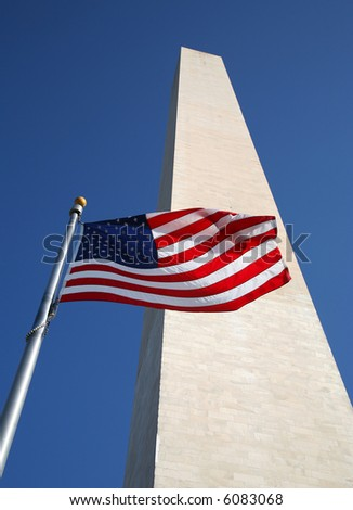 US Flag in front of Washington Monument with Blue Sky
