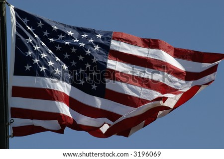 US flag isolated against blue sky