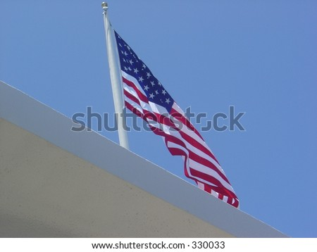 US Flag over USS Arizona Memorial in Pearl Harbor