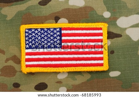 US flag patch on multicam camo background - stock photo