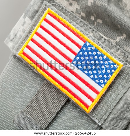 US flag shoulder patch on solder's uniform - stock photo