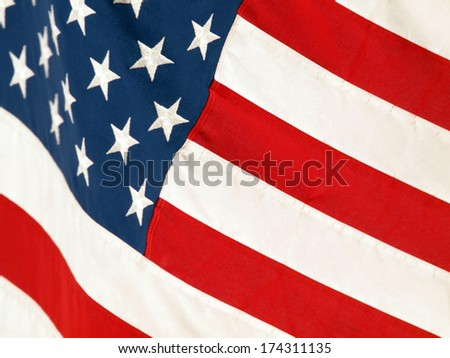 US Flag waves in the wind - stock photo