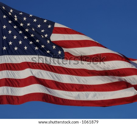 US Flag with Blue Sky Background