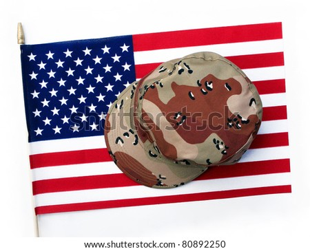 US Flag with Camouflage Cap Combat Hat isolated on white background - stock photo