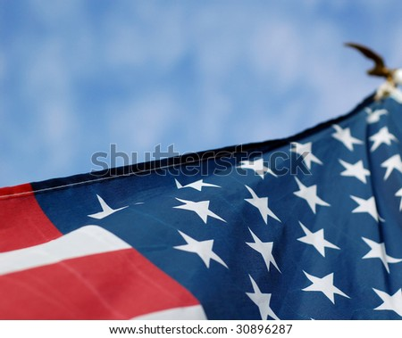 US flag with eagle at top of staff. - stock photo