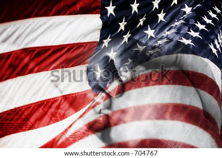 US flag with praying hands over a Bible - shows faith and prayer for country, military, and freedom. - stock photo
