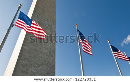 US flags and Washington Monument, DC USA - stock photo
