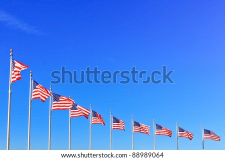 US Flags at the Washington Monument in Washington DC - stock photo