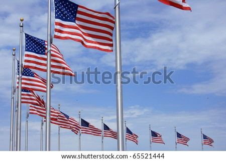 US flags near Washington Monument, Washington DC - stock photo