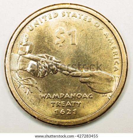 US Gold Dollar Coin Featuring Treaty Wampanoag - stock photo