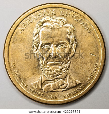 US Gold Presidential Dollar Featuring Abraham Lincoln - stock photo
