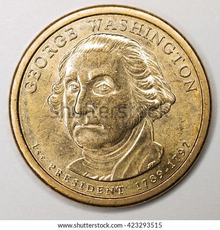 US Gold Presidential Dollar Featuring George Washington - stock photo