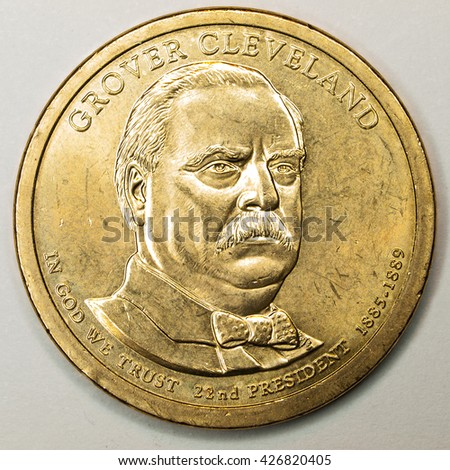 US Gold Presidential Dollar Featuring Grover Cleveland - stock photo