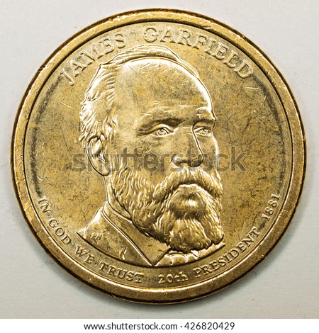 US Gold Presidential Dollar Featuring James Garfield - stock photo