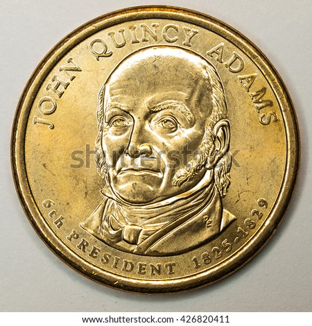 US Gold Presidential Dollar Featuring John Quincy Adams - stock photo